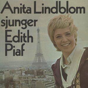sjunger Edith Piaf