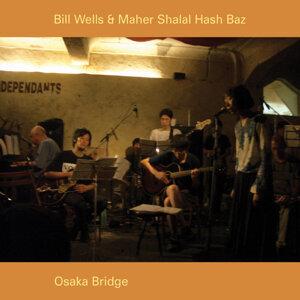 Bill Wells & Maher Shalal Hash Baz