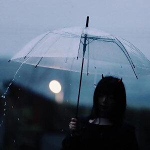 我多麼想為你撐傘